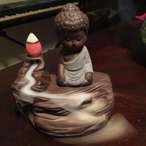 Small Buddha incense holder.